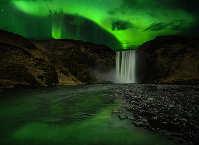 Aurora Borealis above Skógafoss in South Iceland
